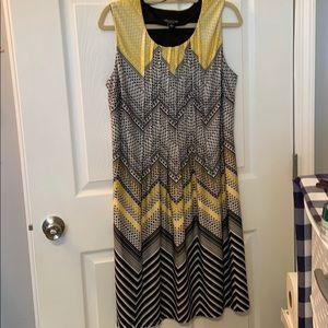 Black, yellow, and white dress.